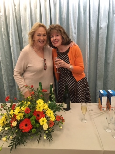 Ethena and Lorraine serving welcome drinks